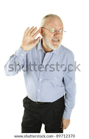 Handsome mature man has trouble to hear on white background
