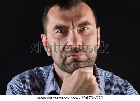 Handsome mature man on a black background. - stock photo