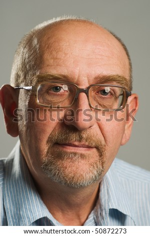 Handsome mature man posing on plain background - stock photo
