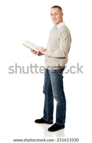 Handsome mature man reading a book. - stock photo