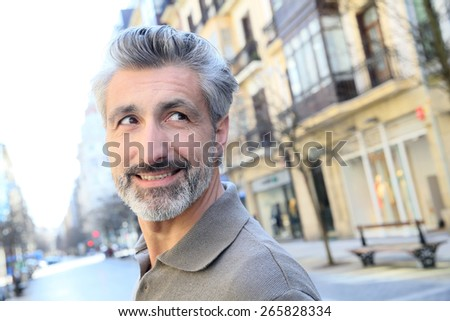Handsome mature man standing in the street - stock photo