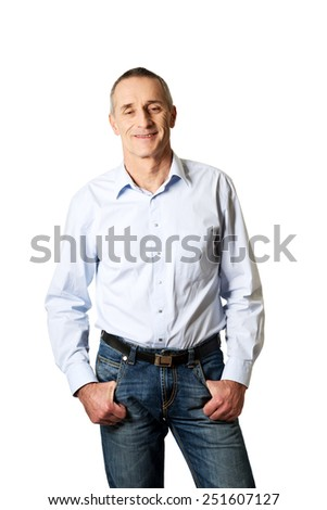 Handsome mature man with hands in pockets.