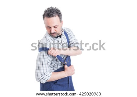 Handsome mechanic putting on his overalls for work with advertising area isolated on white - stock photo