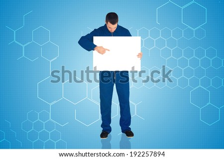 Handsome mechanic showing card against chemical structure in blue and white - stock photo