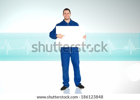 Handsome mechanic showing card against ecg line in blue and white - stock photo