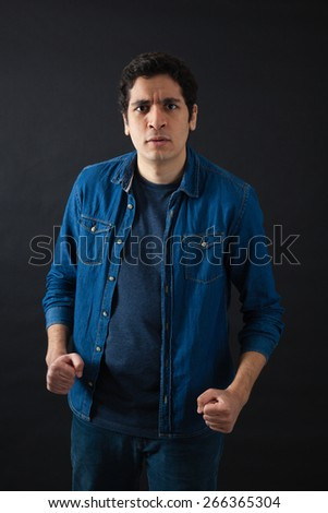 Handsome men doing different expressions in different sets of clothes: angry - stock photo