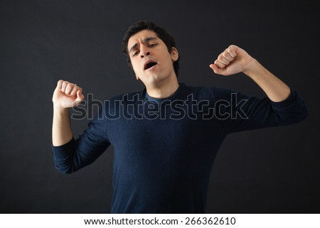 Handsome men doing different expressions in different sets of clothes: wake up - stock photo
