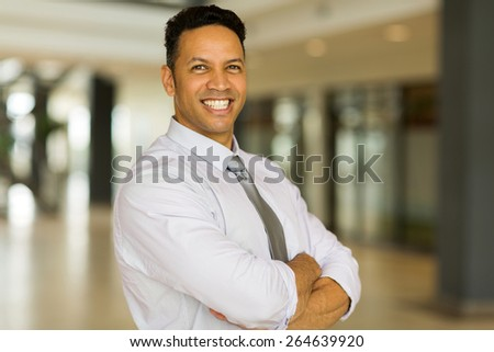 handsome mid age office worker with arms crossed - stock photo