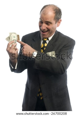 handsome middle age business executive with wad of cash wealthy - stock photo