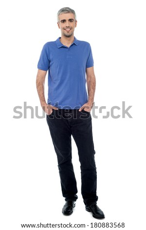 Handsome middle-age man, hands in pockets