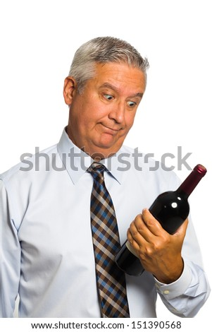 Handsome middle age man holding a wine bottle on a white background. - stock photo