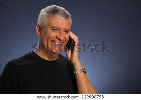 Handsome middle age man in a studio portrait.