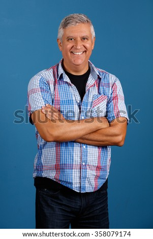 Handsome middle age man portrait with a blue background. - stock photo