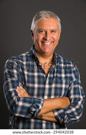 Handsome middle age man studio portrait on a gray background. - stock photo