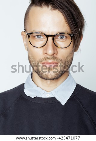 handsome middle age man with modern hairstyle and tattoo, beard, close up on white background