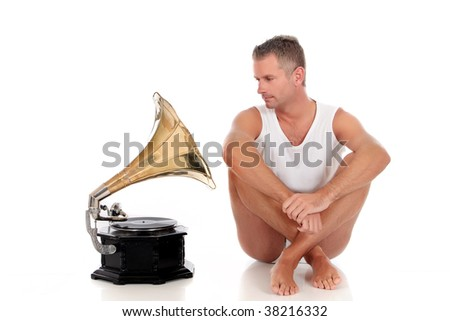 Handsome middle aged man in his forties with antique record player.  Studio white background - stock photo