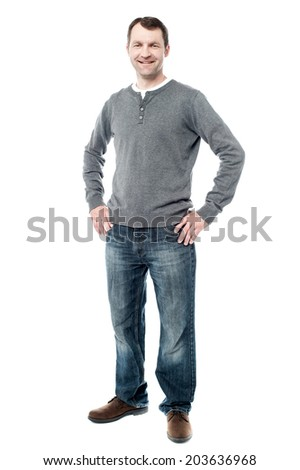 Handsome middle aged man posing with hands on hips - stock photo