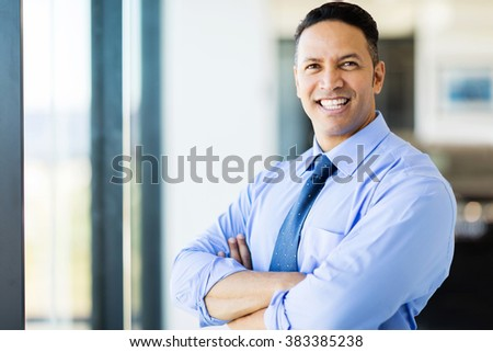 handsome middle aged office worker with arms crossed - stock photo