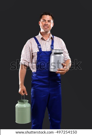 Handsome milkman on dark background
