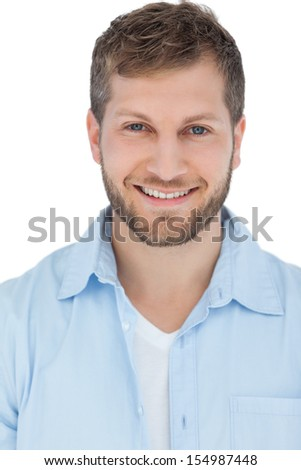 Handsome model smiling in close up on white background