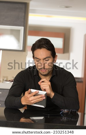handsome modern young man using tablet at home
