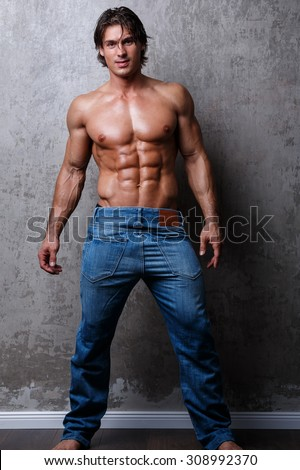 Handsome muscle man in jeans - stock photo