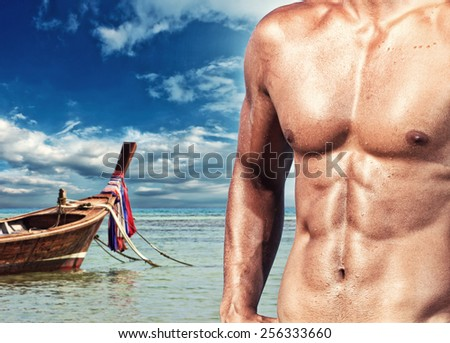 Handsome muscle man on the beach. Thailand. - stock photo