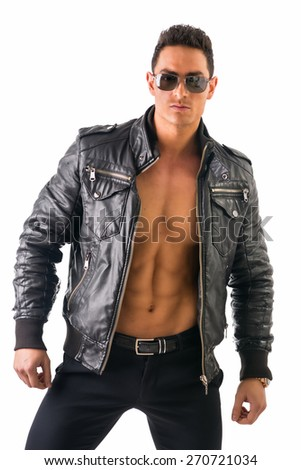 Handsome muscle man wearing leather jacket on naked torso, isolated on white background looking at camera - stock photo