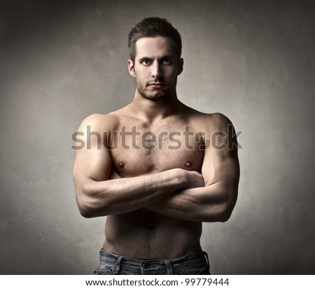 Handsome muscular bare-chested man - stock photo