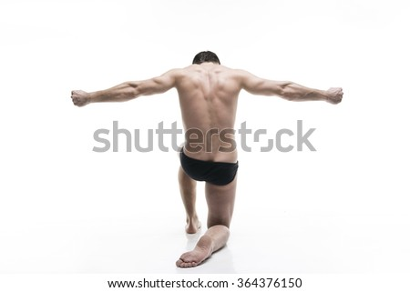 Handsome muscular bodybuilder posing on white background. Isolated studio shot. Sexy male body - stock photo