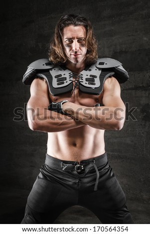 Handsome muscular football player