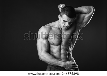 Handsome muscular male body. Male bodybuilder. Muscles of the arms, torso, abdominal muscles. Bodybuilding pose. Concept Proffesional bodybuilding. - stock photo