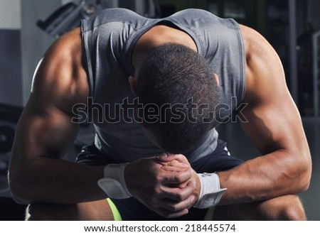 Handsome Muscular Male Model With Perfect Body Posing at the Gym - stock photo