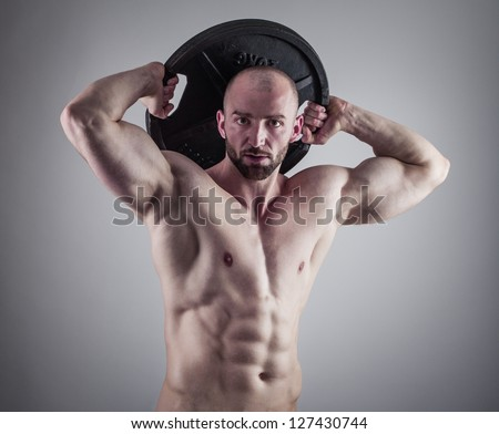 Handsome muscular man - stock photo