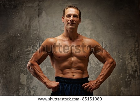 Handsome muscular man. - stock photo