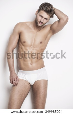 Handsome muscular man in underwear - stock photo
