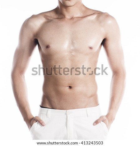 Handsome muscular man on white background