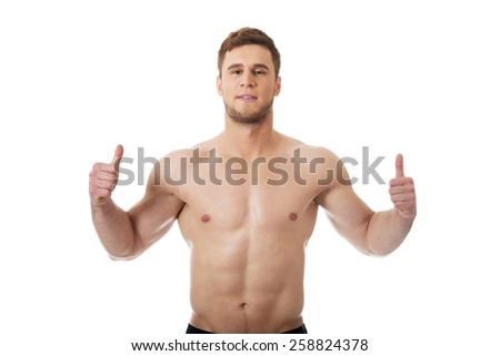 Handsome muscular man showing ok sign.