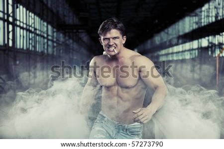 Handsome muscular man walking - stock photo