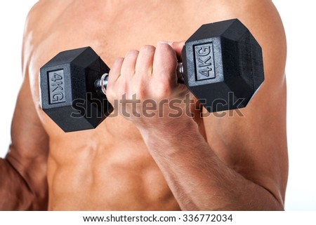 Handsome muscular man working out with dumbbells on white background. Strong bodybuilder with six pack, perfect abs, shoulders, biceps, triceps and chest