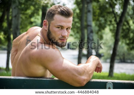 Handsome Muscular Shirtless Hunk Man Outdoor in City Park - stock photo