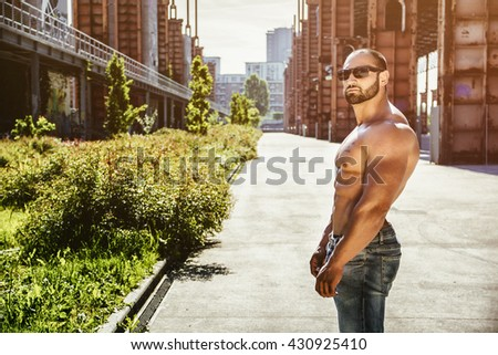 Handsome Muscular Shirtless Hunk Man Outdoor in City Setting - stock photo