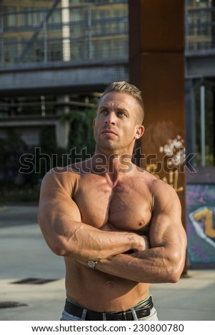 Handsome Muscular Shirtless Hunk Man Outdoor in City Setting. Showing Healthy Body While Looking Up - stock photo
