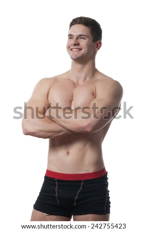 Handsome muscular sportsman posing over white background