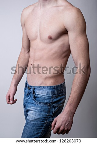 Handsome muscular young man. Shot in a studio. - stock photo