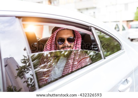 Handsome muslim man traveling and looking through the window.