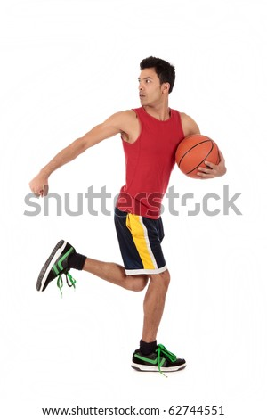 Handsome Nepalese man basketball player running with the ball and looking back. Studio shot. White background. - stock photo