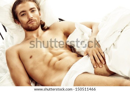 man-lying-nude-in-bed-biblical-views-on-oral-sex