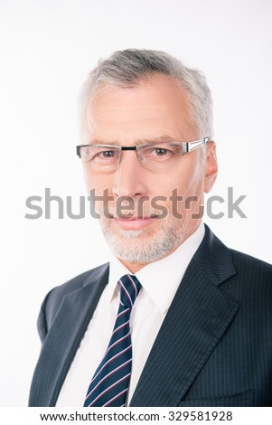 handsome old businessman in a business suit with glasses