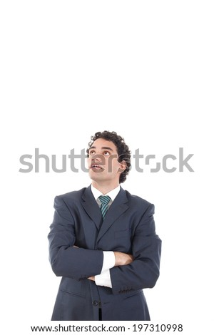 Handsome pensive businessman looking up surprisingly with astonishment, man in suit with arms crossed looking up at copy space against white background wondering - stock photo